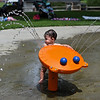 RYAN HUTTON/ Staff photo<br /> Nathan Ogan, 10 months old, plays at the splash pad at the Beverly Homecoming in Lynch Park on Sunday.