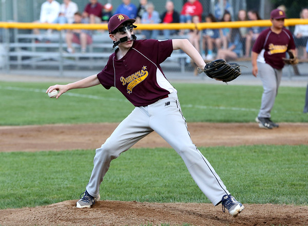 HADLEY GREEN/Staff photo<br /> Danvers National Little League all-star Mike Moroney (12) pitches against Amesbury in the District 15 championship game at Harry Ball Field in Beverly.<br /> <br /> 07/13/2018