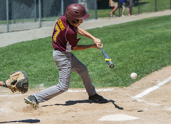 AMANDA SABGA/Staff photo<br /> <br /> Danvers National's Jake Semons (7) at bat during a game against Hamilton-Wenham at the Harry Ball Field in Beverly.<br /> <br /> 7/7/18