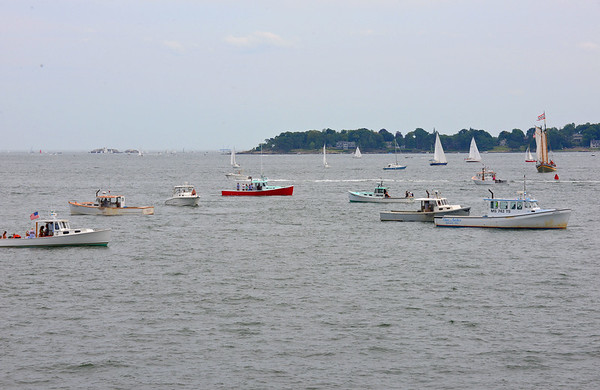 RYAN HUTTON/ Staff photo<br /> Lobster boats gather off of Lynch Park in beverly before the start of the annual Beverly lobster boat races on Sunday.