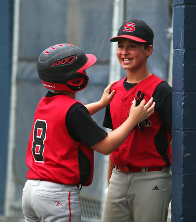 HADLEY GREEN/Staff photo<br /> Salem's Ryan Rocco (1) becomes emotional after scoring a home run at the Lynnfield v. Salem Little League game at Pine Hill in Lynn.<br /> <br /> 07/10/2018