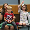 HADLEY GREEN/Staff photo<br /> Lisa Bruce of Gloucester signs with her children Liam and Matilda at the Singing and Signing event at the Sawyer Free Library.<br /> <br /> 07/05/2018