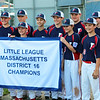 HADLEY GREEN/Staff photo<br /> Peabody West players pose for a photo with the District 16 championship banner after winning the final game against Lynnfield at the Reinfuss Field in Lynn. <br /> <br /> 07/12/2018