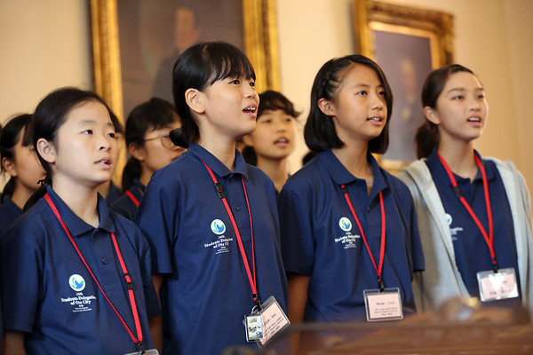 HADLEY GREEN/Staff photo<br /> Students from Ota, Japan sing in the City Council chamber at Salem City Hall. A group of 34 residents from Ota are visiting Salem as part of the sister city exchange tradition. <br /> <br /> 07/26/2018