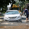 HADLEY GREEN/Staff photo<br /> Beverly resident Greg Dry moves his car after a water main break causes the road to buckle on the corner of Bartlett Street and Wentzell Ave in Beverly.<br /> <br /> 07/17/2018