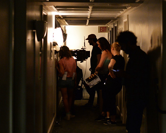 """RYAN HUTTON/ Staff photo<br /> The crew of the film """"Selah and the Spades"""" works in a tight hallway at The Academy at Penguin Hall in Wenham on Wednesday as they shoot a scene in the upcoming feature film."""