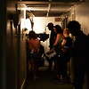 "RYAN HUTTON/ Staff photo<br /> The crew of the film ""Selah and the Spades"" works in a tight hallway at The Academy at Penguin Hall in Wenham on Wednesday as they shoot a scene in the upcoming feature film."