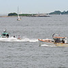 RYAN HUTTON/ Staff photo<br /> A pair of lobster boats speed away from the harbor as seen from Lynch Park in Beverly during the annual Lobster boat races on Sunday.