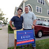 "RYAN HUTTON/ Staff photo<br /> Vinny Egizi, right, stands with his son Marco, left, with the sign that Marco got his dad for his birthday recently. It reads; ""Vinny Egizi, I'm not running for anything, I just wanted my own sign."""