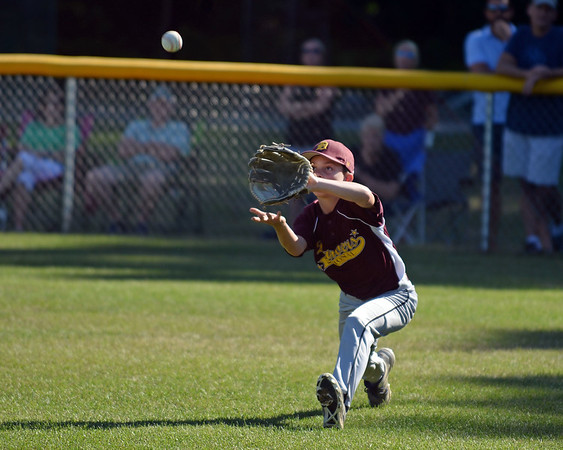 RYAN HUTTON/ Staff photo<br /> Danver's Nick Lembo gets under a fly ball to make the out in the bottom of the first inning of Wednesday's Little League tournament game against Peabody West in Andover.