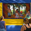RYAN HUTTON/ Staff photo<br /> Parents watch as their kids jump in a bounce house at the Beverly Homecoming in Lynch Park on Sunday.