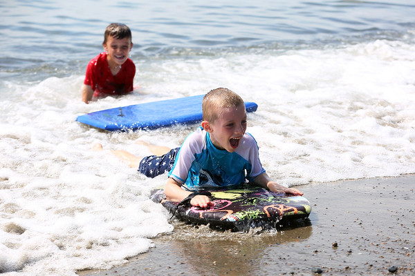 HADLEY GREEN/Staff photo<br /> Jackson Moore, 6, of Marblehead rides the waves at Devereaux Beach in Marblehead. <br /> <br /> 07/31/2018