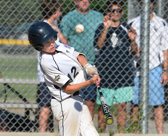 CARL RUSSO/Staff photo Hamilton's Brae Hurley swings hard and fouls tips the ball. North Andover defeated Hamilton- Wenham 8-5 in Little League sectional baseball action. 7/19/2019