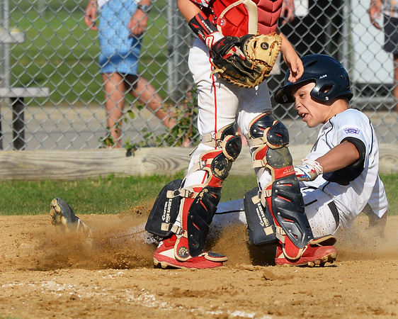 CARL RUSSO/Staff photo Hamilton's Gian Gamelli slides hard at home plate to score. North Andover defeated Hamilton- Wenham 8-5 in Little League sectional baseball action. 7/19/2019