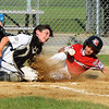 CARL RUSSO/Staff photo Hamilton's catcher, Tyler Russo makes the tag on North Andover's Ben Iglesias for the out.  North Andover defeated Hamilton- Wenham 8-5 in Little League sectional baseball action. 7/19/2019