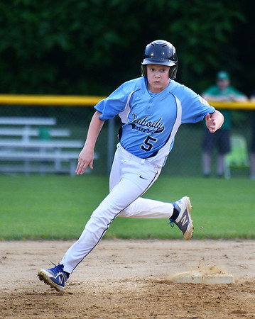 CARL RUSSO/Staff photo.Peabody's Matt Smith rounds second base and sprints to third. Peabody vs. Woburn in Little League baseball action. 7/19/2019