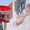 Artists working on murals in Beverly