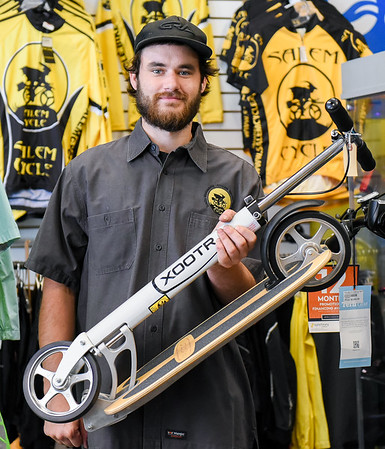 Salem Cycle sells some scooters to Adam Sandler and family