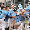 CARL RUSSO/Staff photo. Peabody players celebrate at the plate with Jayce  Jeanpierre, 11 after he hit the first home run of the game. Peabody vs. Woburn in Little League baseball action. 7/19/2019