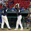 DAVID LE/Staff photo. St. John's Prep senior Jack Arend, left, and junior Chris Francoeur (3) celebrate after crossing the plate with two Eagles' runs. 6/16/16.
