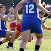 DAVID LE/Staff photo. Masco senior captain Molly Gillespie, right, gets tripped up by Danvers junior Morgan Mscisz, left. 6/2/16.