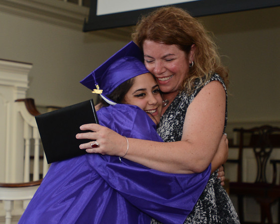RYAN HUTTON/ Staff photo<br /> Northshore Recovery High School graduate Emilia Collado hugs school director Michelle Lipinski as she gets her diploma at the school's commencement ceremony at the Second Congregational Church in Beverly on Wednesday night.