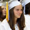 DAVID LE/Staff photo. Danvers High School graduate Kristen McCarthy smiles while listening to a speech at graduation. 6/11/16.