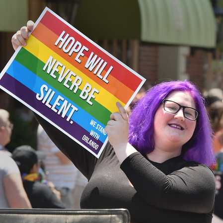 Becky Fisk, a Youth Advisor for the North Shore Alliance for Gay, Lesbian, Bisexual, Transgender Youth, shows her support during the parade.<br /> <br /> Photo by joebrownphotos.com