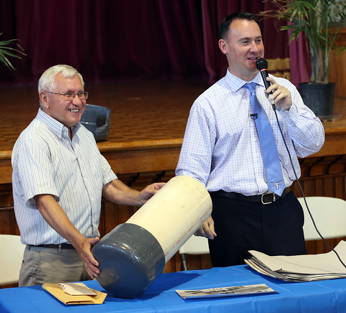 DAVID LE/Staff photo. Peabody Mayor Ted Bettencourt, with the assistance of former Mayor Michael Bonfanti, left, opened two time capsules from 1981 and1989 inside the Wiggin Auditorium at Peabody City Hall on Wednesday afternoon. 6/29/16.