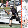 DAVID LE/Staff photo. Ipswich junior captain Kilian Morrissey winds up for his first quarter goal against Dover-Sherborn in the D3 State semifinal on Tuesday afternoon. 6/14/16.