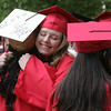 KEN YUSZKUS/Staff photo.   Marblehead High School graduates Samantha Payne, right, and Janely Rodriguez greet and hug outside the school before the ceremony.     06/12/16