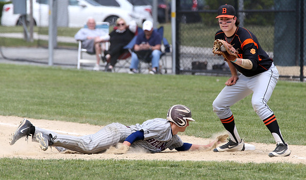 KEN YUSZKUS/Staff photo.     Belmont Paul Ramsey gets back to 1st base safely as Beverly's Rick Johnson gets the throw on a pickoff try during the Belmont at Beverly baseball state tournament game.     06/02/16
