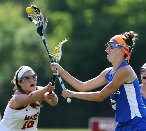 DAVID LE/Staff photo. Danvers senior Allie Zunick fires home a goal before Masco junior Grace Fahey can interrupt her shot on Thursday afternoon. 6/2/16.
