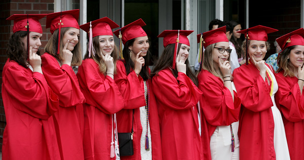 KEN YUSZKUS/Staff photo.   Graduates pose for photos outside Marblehead High School before to the graduation ceremony.     06/12/16