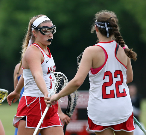 DAVID LE/Staff photo. Masco senior captain Molly Gillespie, left, is greeted by freshman teammate Taylor Flynn (22) after Gillespie's 2nd goal of the game against Danvers in the D1 North quarterfinal on Thursday afternoon. 6/2/16.