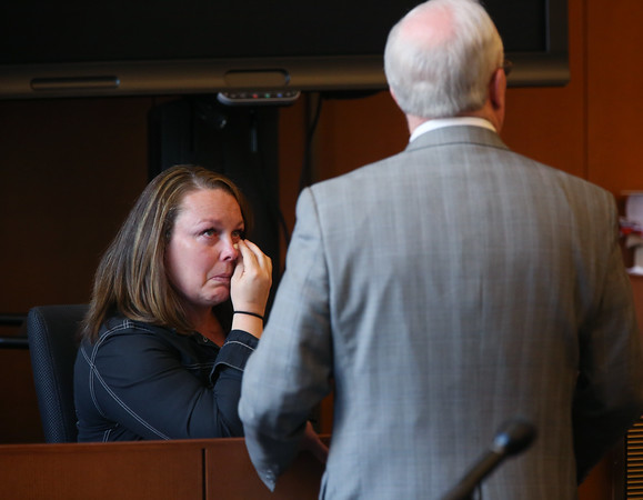 KEN YUSZKUS/Staff photo.   Lisa Haney Bilodeau sits at the witness stand in Salem Superior Court. She plead guilty of faking her credentials to obtain a school nurse's job in Haverhill.         06/17/16
