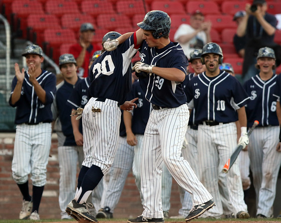 DAVID LE/Staff photo. St. John's Prep Andrew Selima, right, bashes forearms with senior teammate Sean McGinnish after Selima's two-run homer against Braintree. 6/16/16.