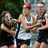 DAVID LE/Staff photo. Marblehead freshman Grace Arthur (3) looks to take a shot while being closely defended by Ipswich senior Renee DiNocco (5). 6/9/16.