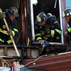 DAVID LE/Staff photo. Salem firefighters make sure a fire that broke out on the third floor of 38 Harbor Ave in Salem is put out on Friday afternoon. 6/24/16.
