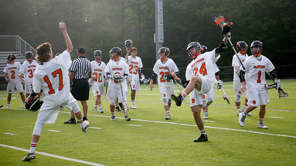 Beverly: During the North Division 2 playoff quarterfinal held at Endicott College on Saturday afternoon. Beverly beat Burlington 14-9. Beverly's Kevin Morency, far left, and teammate Noah Kaplan react to winning the game. Photo by Allegra Boverman