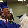 DAVID LE/Staff photo. Danvers graduate Kevin Grullon bursts out laughing at a quote read by senior class essayist Kelly Ann Lewis at graduation on Saturday afternoon. 6/11/16.