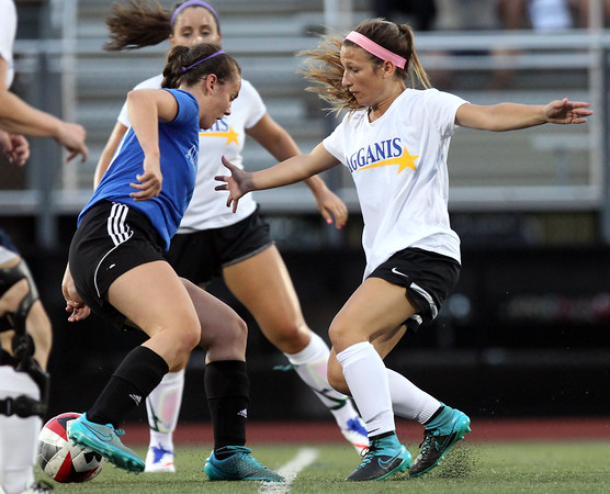 DAVID LE/Staff photo. University of Delware commit Katrina Silva, of Peabody, closely defends an opposing player during the Agganis Girls Soccer game on Tuesday evening. 6/28/16.