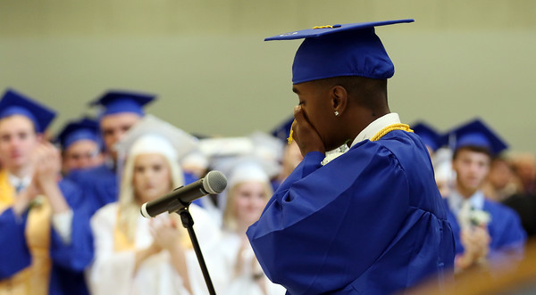 """DAVID LE/Staff photo. Danvers High School graduate Tre Crittendon shows emotion at the outpouring of support from a standing ovation after his speech """"Family,"""" in which he thanked the Danvers community for showing him the true meaning of what it is to be a family. 6/11/16."""