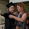 RYAN HUTTON/ Staff photo<br /> Northshore Recovery High School graduate Mathew Charles Dow gets his diploma from school director Michelle Lipinski at the school's commencement ceremony at the Second Congregational Church in Beverly on Wednesday night.