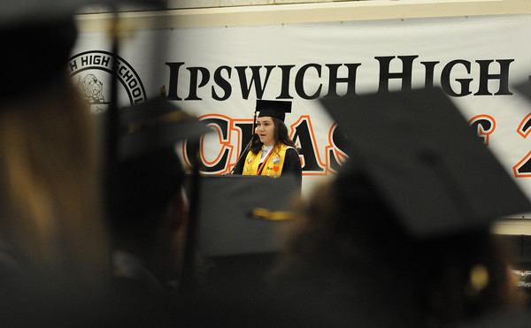 PAUL BILODEAU/Staff photo. Valedictorian Lilly Kallman delivers her speech during Ipswich High School's graduation ceremony in the field house at the school.