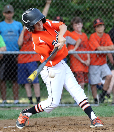 DAVID LE/Staff photo. Beverly's Griffin Francis lines a hit against Danvers on Wednesday evening in District 15 action. 6/29/16.