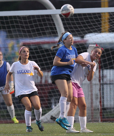 DAVID LE/Staff photo. Salem's Nicole Sadoway, center, wins a header in between Hamilton-Wenham's Molly Eagar, right, and Peabody's Katrina Silva, in the annual Agganis Girls Soccer Classic. 6/28/16.