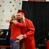 PAUL BILODEAU/Staff photo. Ashley Skeffington hugs her brother, Bailey Skeffington, after he received his diploma during Salem High School's graduation ceremony in the high school's field house.
