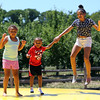 DAVID LE/Staff photo. Siblings Serena, 8, Wesley, 4, and Riley Ayemere, 11, of Tyngsboro, hop up and down on a bouncy-mat at the annual Strawberry Festival held at Connors Farm in Danvers as part of the Danvers Family Festival. 6/18/16.