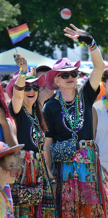 Gardene MacKenzie (l) and Nancy Nangeroni (one of the Fabulous Five honorees) enjoy the vocal stylings of Gunpowder Gelatine during the North Shore Pride Parade.<br /> <br /> Photo by joebrownphotos.com
